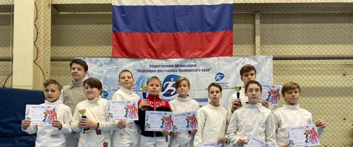 ILS 6th grader on winning team at fencing tournament